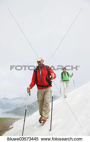 "Stock Image of ""Couple moving over a snow field during their hike."