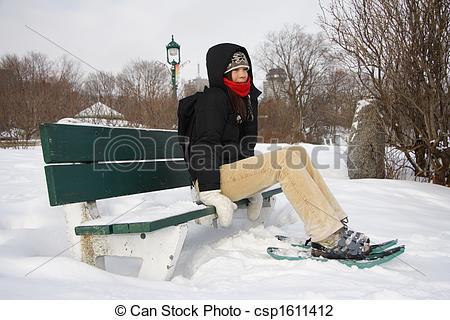 Stock Photo of Young woman hiking with Snow shoes / Rackets.