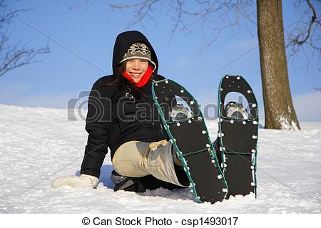 Picture of Young woman hiking with Snow shoes / Rackets.