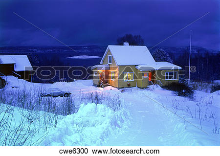 Stock Photography of Evening lights from snowbound home on long.