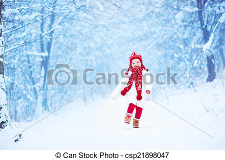 Stock Photo of Little girl running in a snowy park.