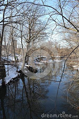 Snowy Riverbank Landscape Stock Photo.