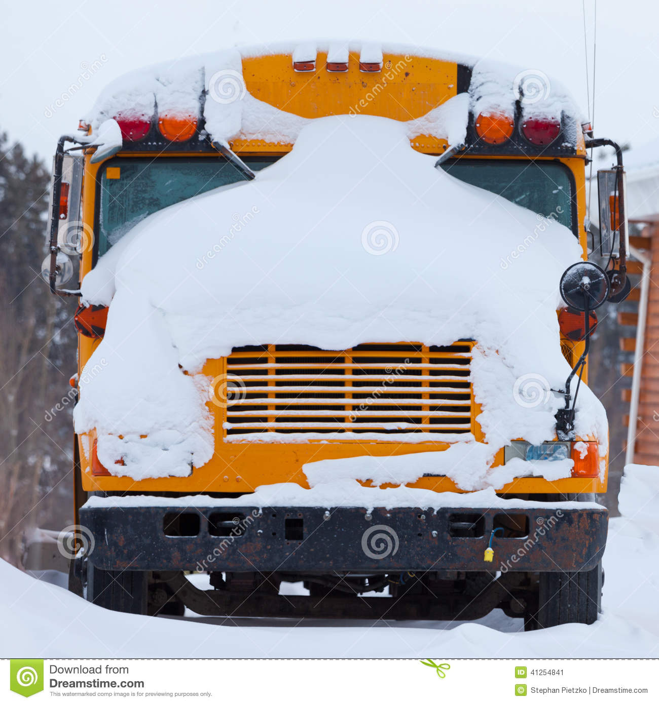 Parked School Bus Winter Blizzard Snow Cover Stock Photo.