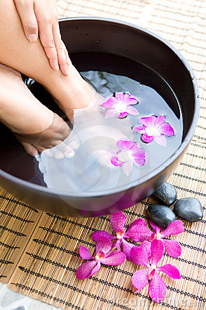 Woman With Feet Soaking Royalty Free Stock Image.