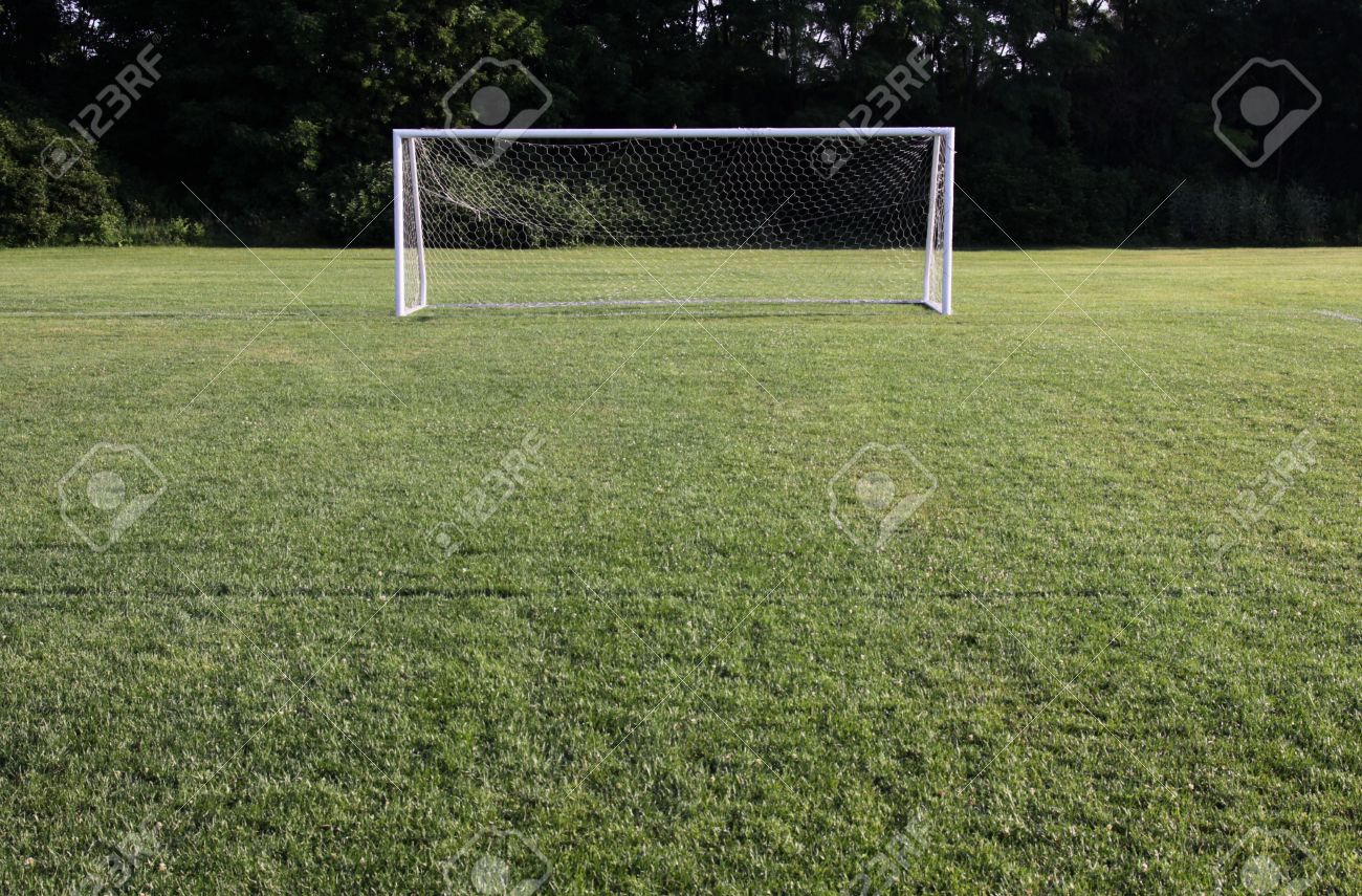 A Soccer Net With Shot In Bright Sunlight With Trees In The.