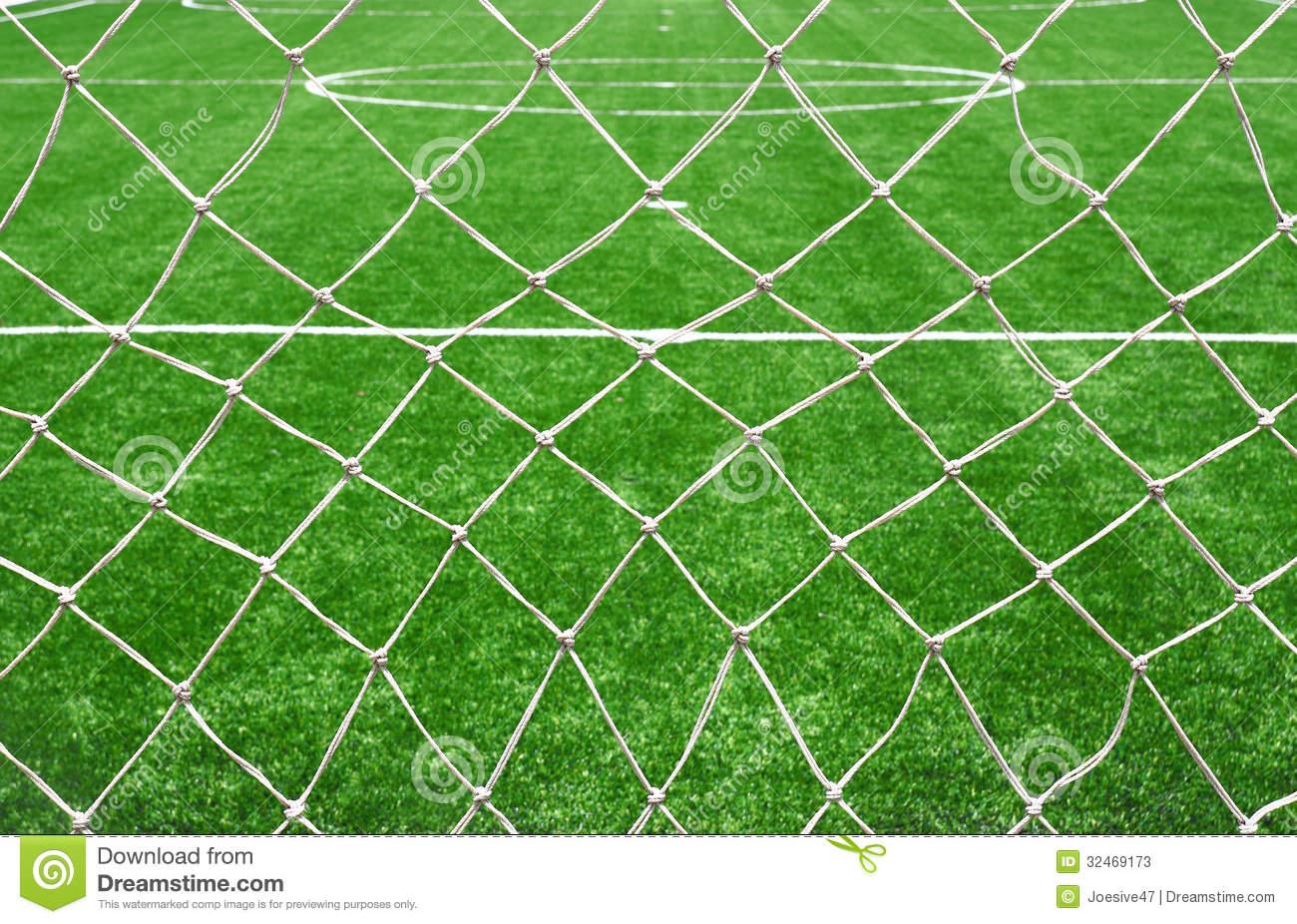 Soccer Net On Green Grass Stock Photos.