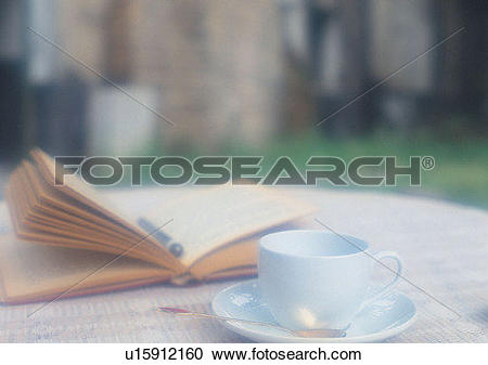 Stock Photography of grass, romantic, book, cup, pen, soft focus.