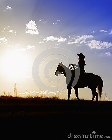 Beautiful Cowgirl On Horse In Sunset Stock Image.