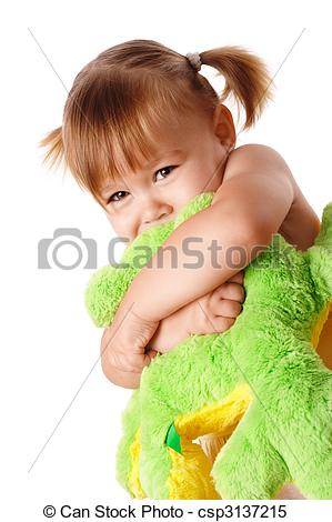 Stock Images of Cute girl embracing her soft toy.