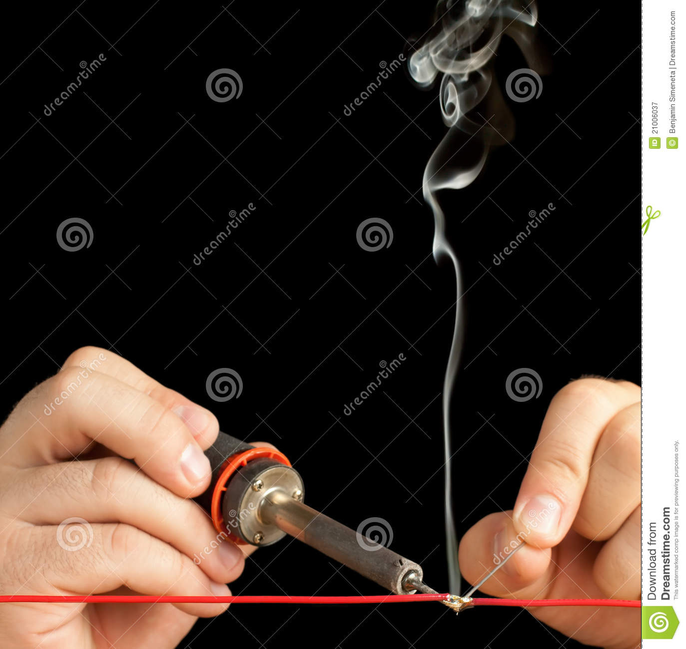 Technician Bonding Two Wires With A Solder Joint. Royalty Free.