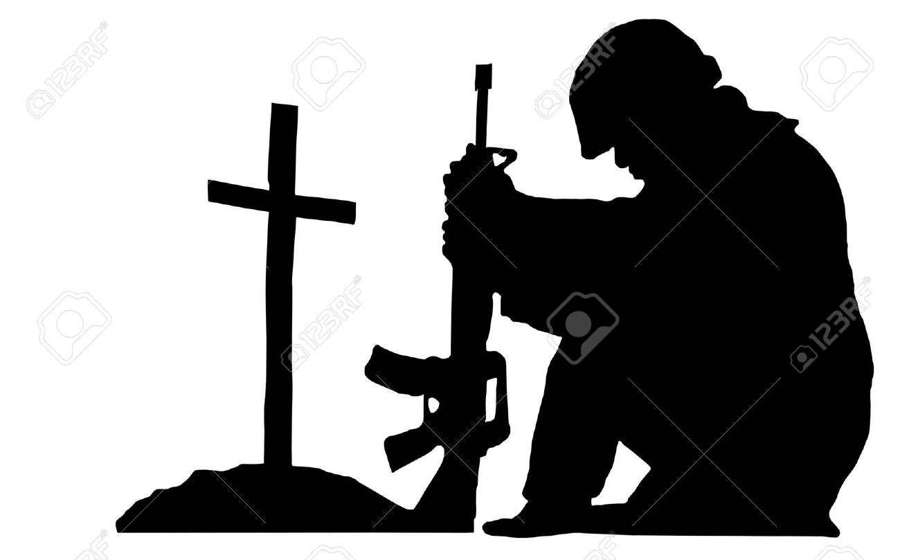 Silhouette Of A Soldier Kneeling Next To The Grave Of A Friend.