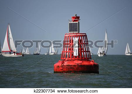 Stock Photo of lymington bank red marker channel buoy on the.