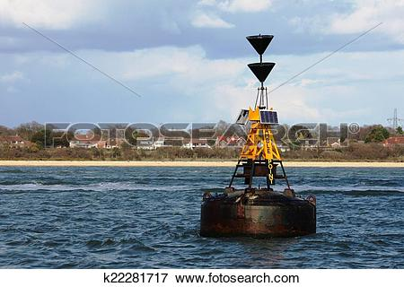 Picture of hamble point south cardinal marker floating in the.