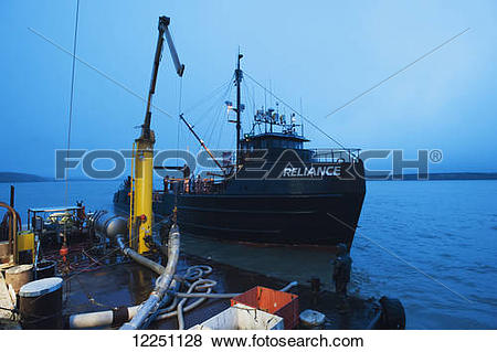 "Pictures of ""The tender Reliance arrives at the cannery to offload."