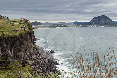 Steep Cliff Next To Songaksan Mountain On Jeju Island Stock Photo.