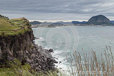Steep Cliff Next To Songaksan Mountain On Jeju Island Stock Photo.