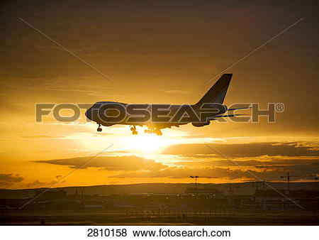 Pictures of Silhouette of commercial airplane in flight, Frankfurt.