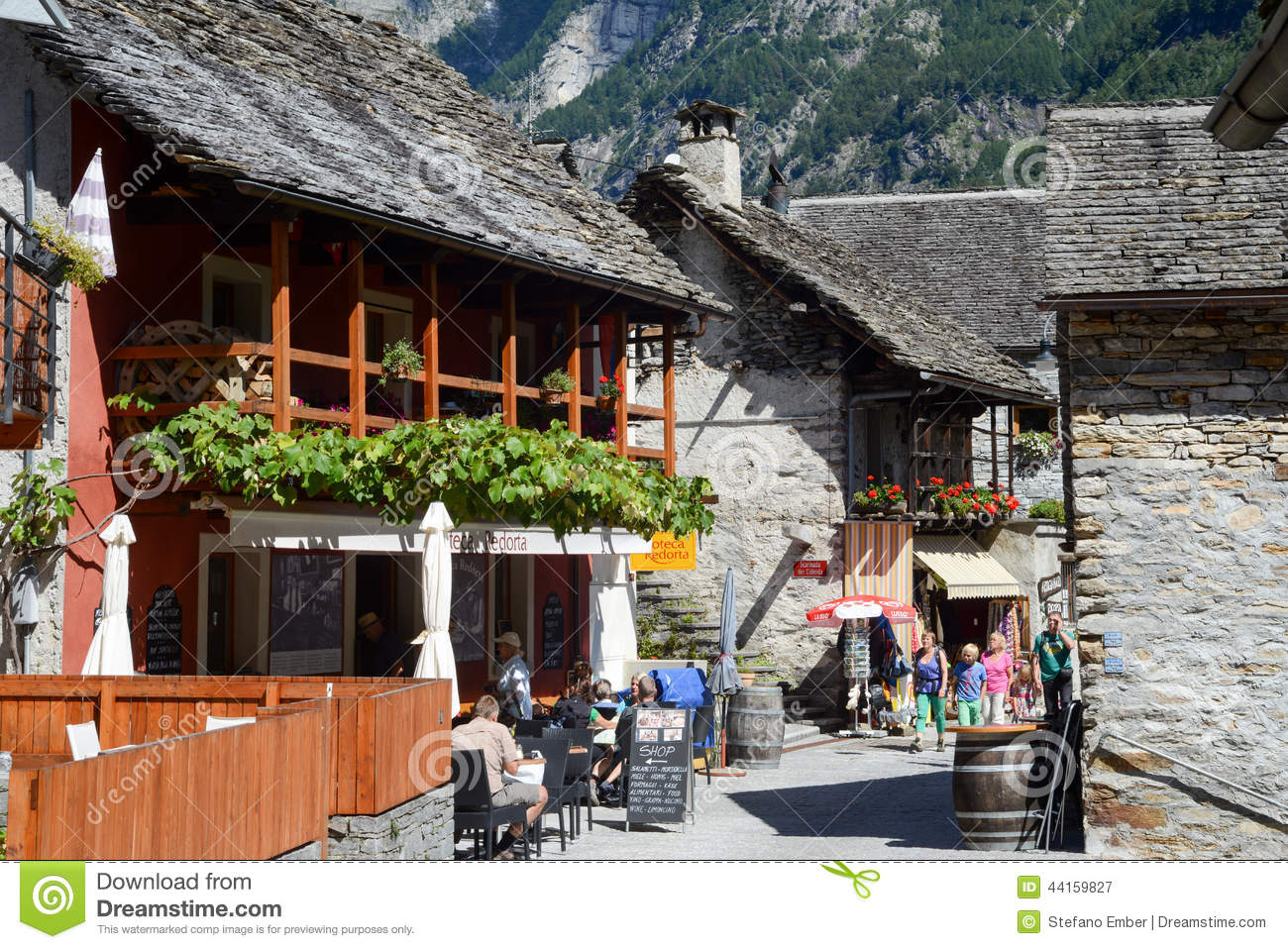 Tourists Visiting The Rural Village Of Sonogno On Verzasca Valle.