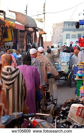 Stock Photograph of Busy souk market street of Marrakech Morocco.