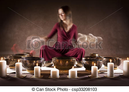 Stock Photography of Meditation with Tibetan singing bowls.