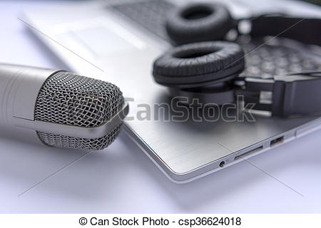 Stock Photography of Microphone and headphones on laptop. sound.