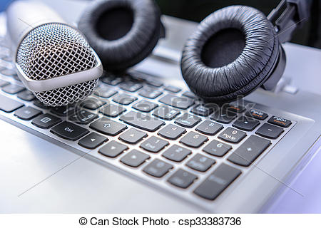 Stock Photos of Microphone and headphones on laptop. sound editing.