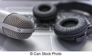 Stock Image of Microphone and headphones on white table. sound.