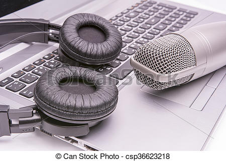 Stock Photography of Microphone and headphones on laptop sound.