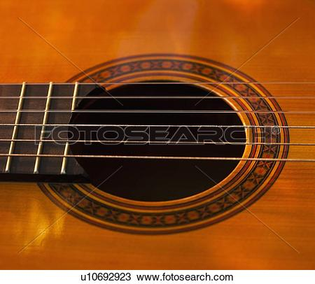 Stock Photo of Close up of sound hole of acoustic guitar u10692923.
