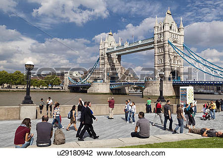 Stock Photo of England, London, Tower Bridge. People walking along.