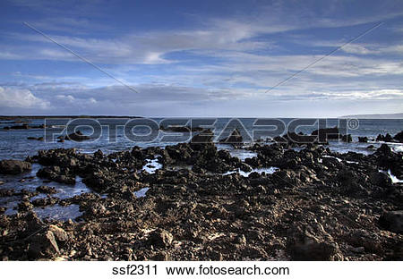 Stock Photography of Lava flow meets ocean on the south coast of.