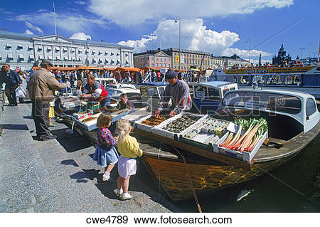 Stock Photograph of People buying and selling fresh fish off back.