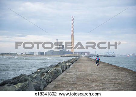 Stock Photo of Lone cyclist on Great South Wall walk, Dublin.