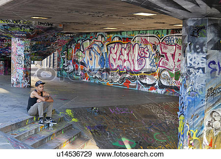 Stock Photograph of England, London, South Bank. Resting cyclist.