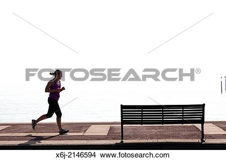 Stock Photo of Woman jogger on Southsea Promenade. x6j.