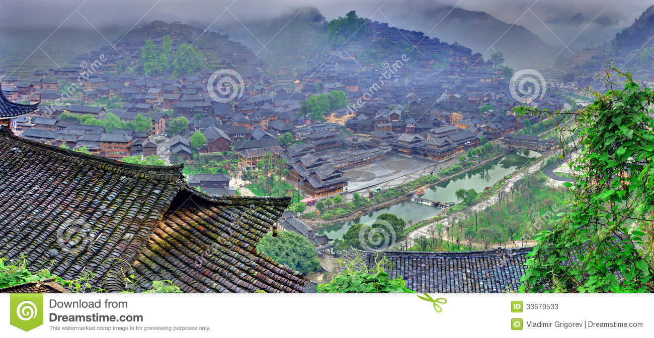 Fog And Clouds In Big Mountain Village In Southwest China. Stock.