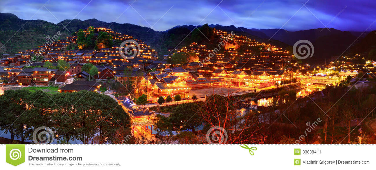 Night View Of The Large Ethnic Village In Southwest China. Stock.