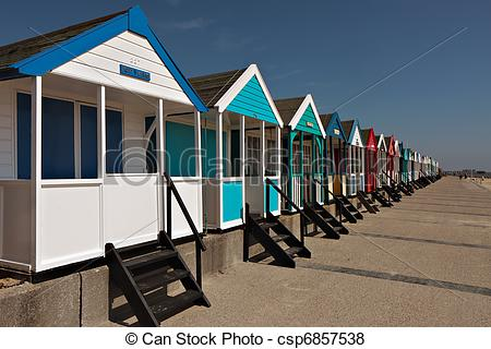 Pictures of A row of brightly coloured beach huts in Southwold.