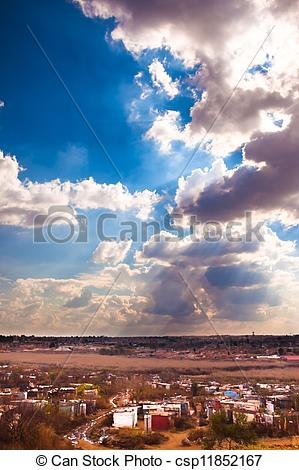 Stock Image of Soweto shantytown street and bush.