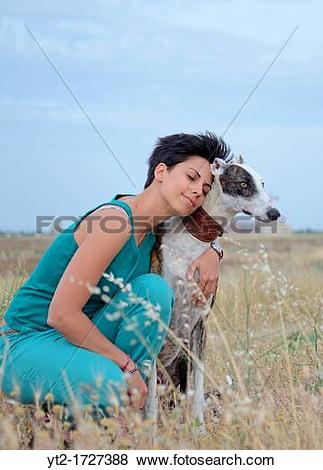 Pictures of Young attractive woman with her Spanish greyhound in.