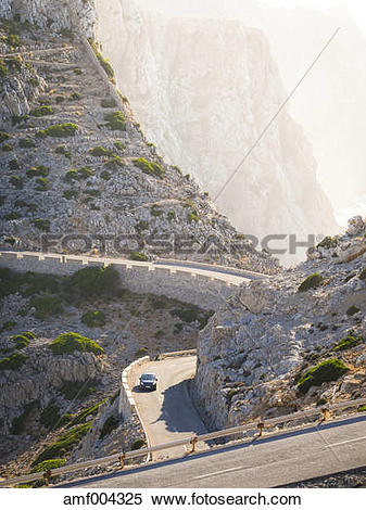 Stock Image of Spain, Mallorca, Cap Formentor, car driving on.