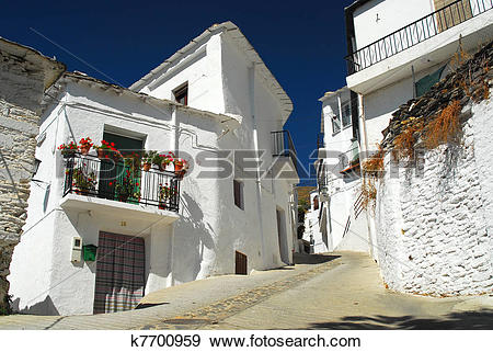Stock Photograph of Narrow street in Spanish village k7700959.