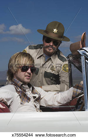 Stock Photo of Police officer with pulled over speeder x75554244.