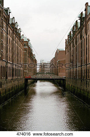 Stock Images of Canal between buildings, Speicherstadt, Hamburg.