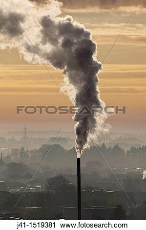 Stock Photography of Chimney spews smoke, winter dawn from Port.