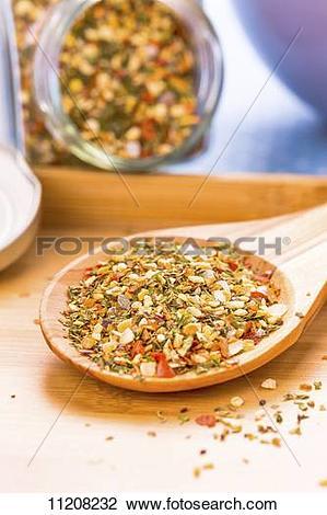 Stock Photo of Bruschetta spice mix on a wooden spoon 11208232.