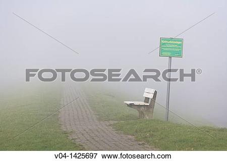 Picture of Deserted bench on a foggy day on the east frisian.