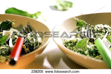 Stock Image of Ricotta dumplings with spinach, sage, Parmesan.