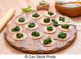 Stock Photos of Dough circle filled with spinach ready to prepare.