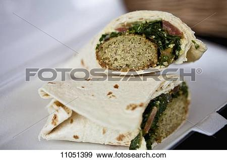 Stock Photograph of Greek wraps with minced meat and spinach.